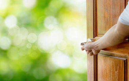 Man hand open door Handle the rocking shaft or opens empty room door to nature