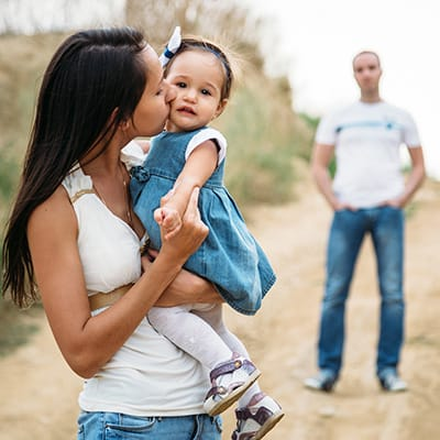 A couple with a child seemingly having marital problems